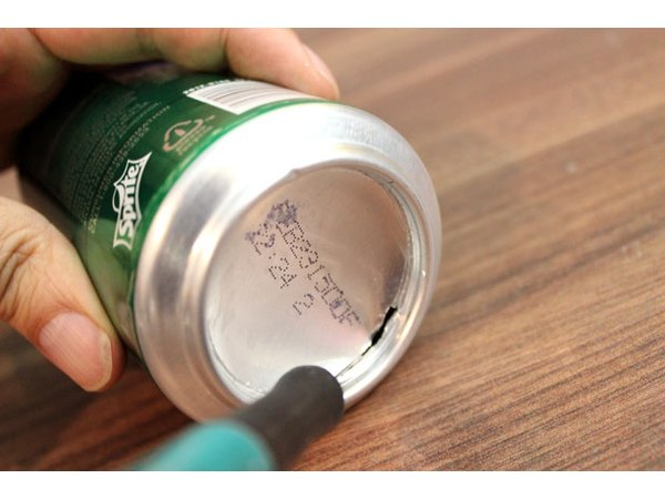Cut out the bottom of the can