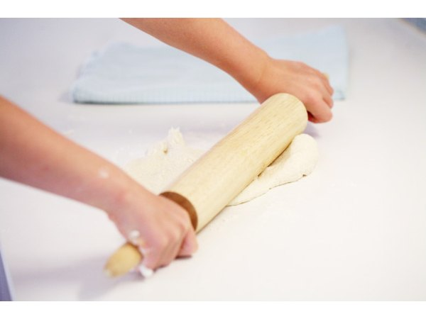 Roll out the dough on a floured board.