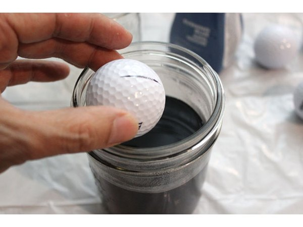 Drop the golf ball in the jar