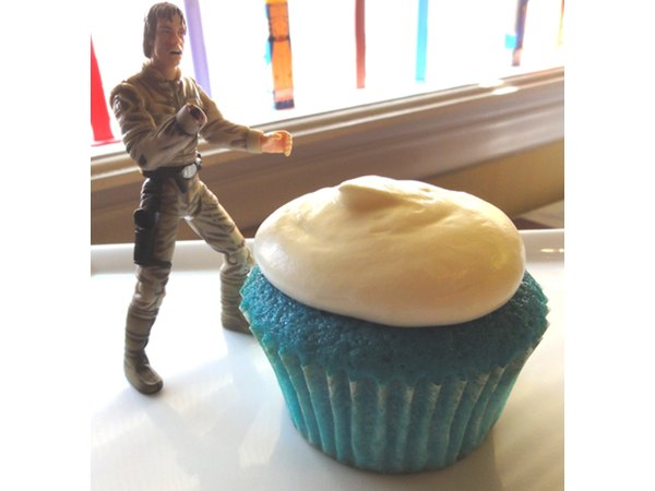 Blue milk cupcakes are still easy to eat after you get your hand cut off with a light saber.