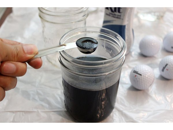 Fill a jar with water and liquid dye
