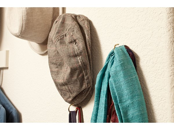 Hooks can hold items both big and small, making excellent use of spare vertical space.
