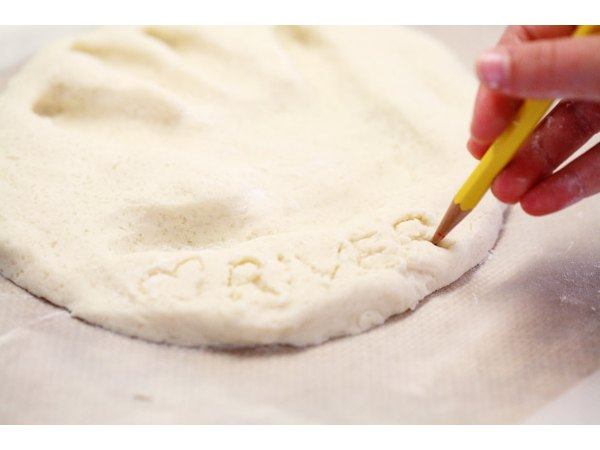 Etch your child's name into the dough.