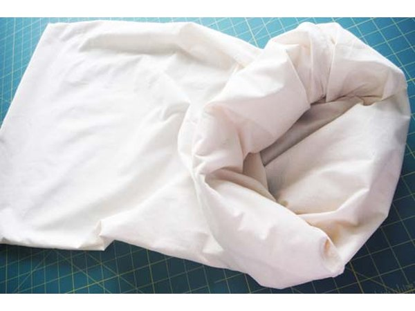 Unroll as you stuff the pillow.