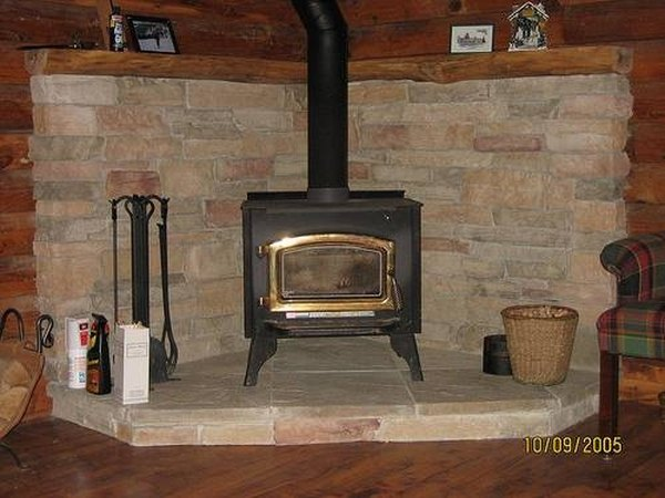Go green and save with a wood stove surround - About Wood Stove Surrounds (with Pictures) EHow