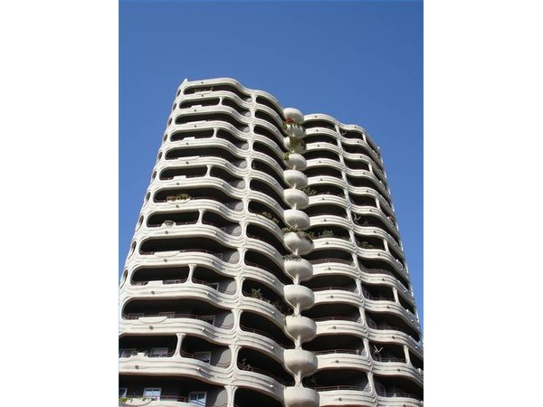 A modern apartment building with balconies in Malaga, Spain.
