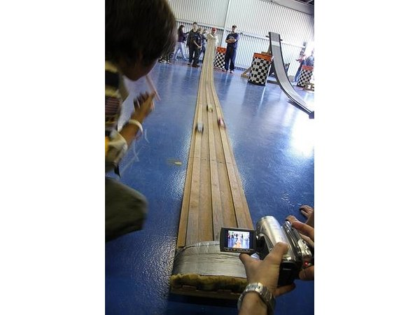 Pinewood derby race track with three lanes.