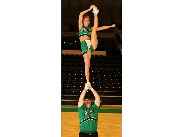 These Sioux cheerleaders demonstrate a good coed bow and arrow.