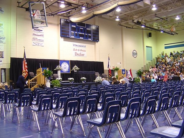 High school graduation in the gym.