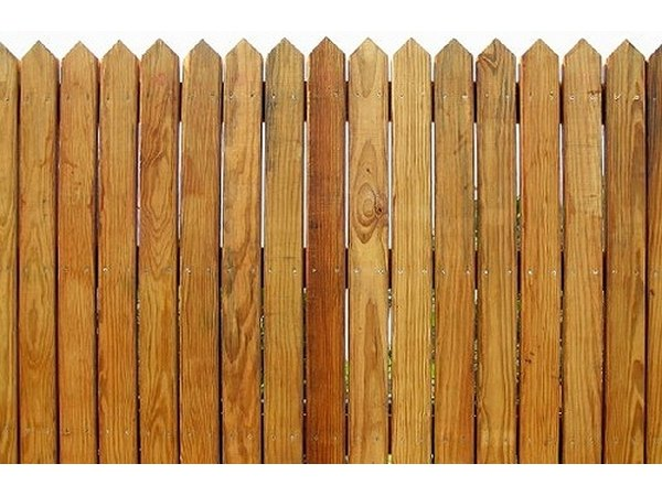 This cedar stockade style fence uses standard grade pickets.