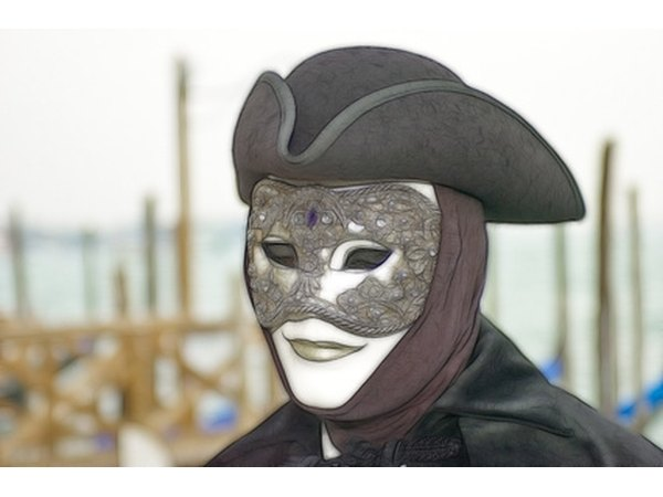 The mask and folds of the cloak are examples of implied texture.