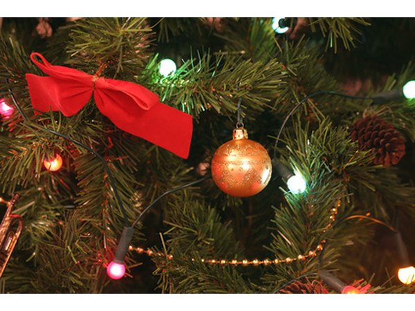 A Christmas tree should be secured in its stand prior to decorating with lights.