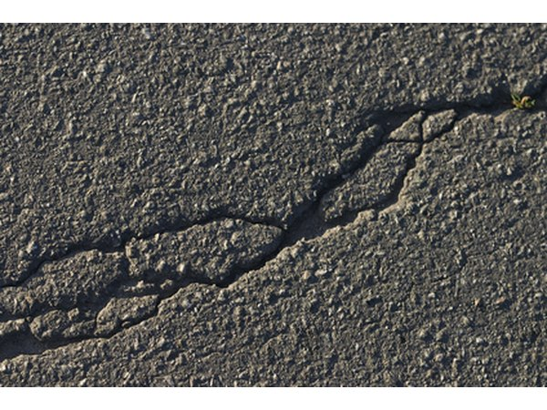 Worn, slightly cracked asphalt can be repaired with an asphalt resurfacer.