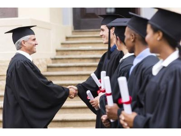 Dean shaking hands with students