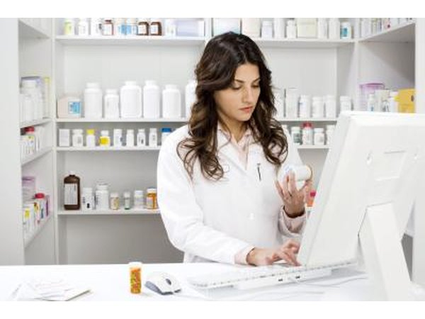 pharmacist with prescription bottle in hand