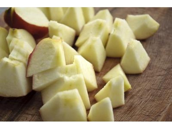 Chopped apple pieces on a wood table