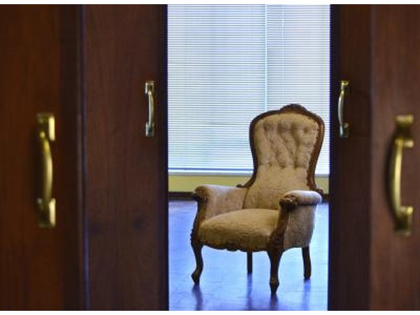 Victorian chair behind open doors