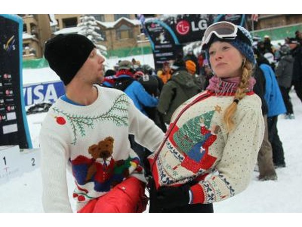 Snowboarders showing off sweaters at team event