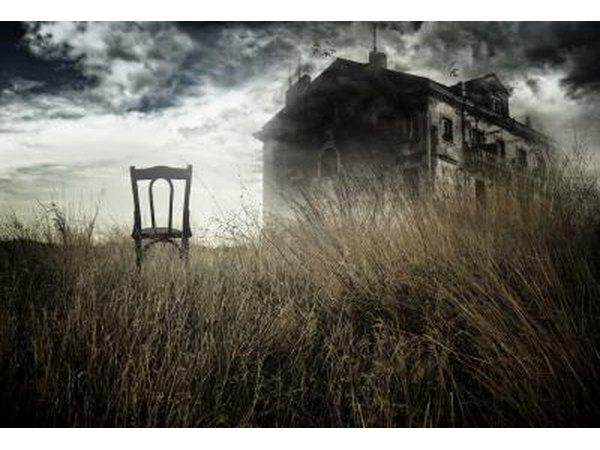 Chair in field next to old house