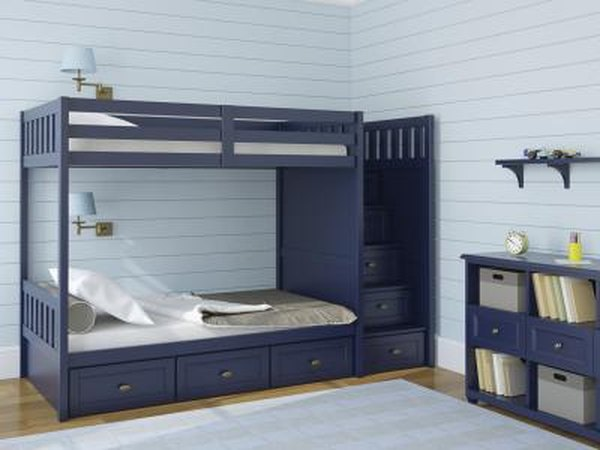 A children's room with navy blue furniture.