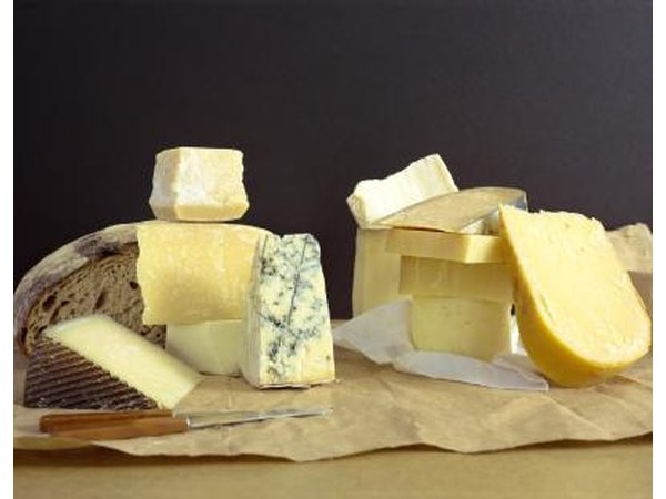 A variety of cheeses on a block