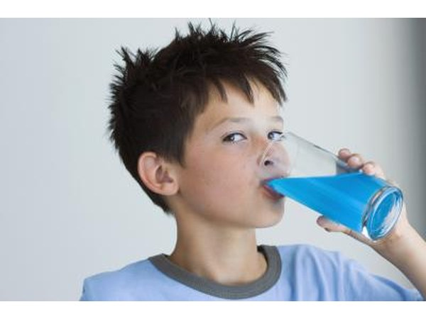 child drinking blue juice