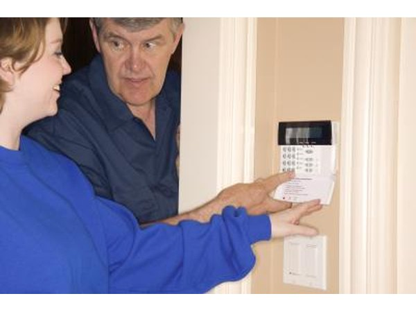 Technician and woman at thermostat