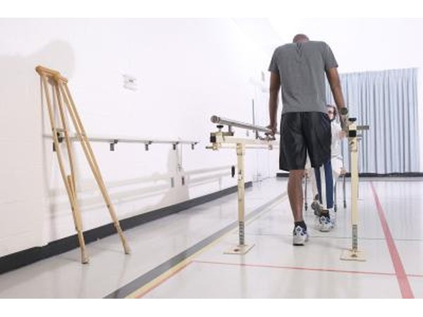 Man in physical therapy room for leg