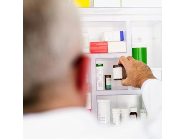 Man reaching for medication in cabinet