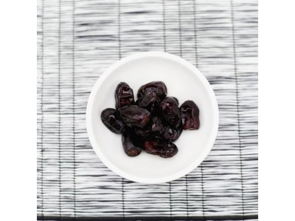 Bowl of dried prunes.