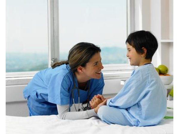 Young boy in hospital with doctor.