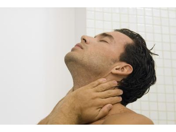 A man expieriences pain in the base of his neck.