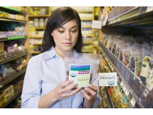 Woman reading food label in grocery store.