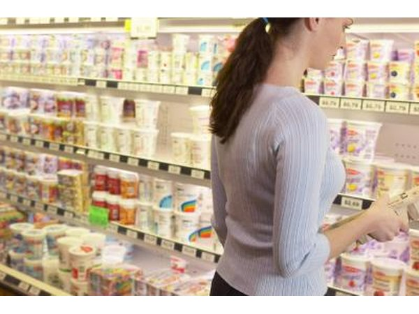 Woman in dairy aisle at supermarket
