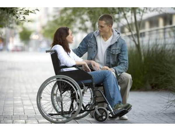 Woman in wheel chair talking to boyfriend