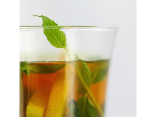 Close up of herbal tea with fresh herbs.