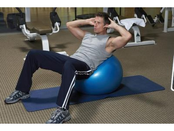 Man using a stability ball to do crunches.