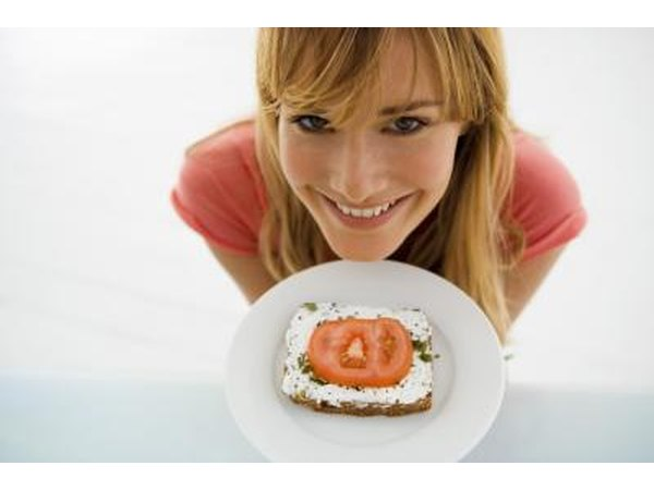 woman with plate of toast