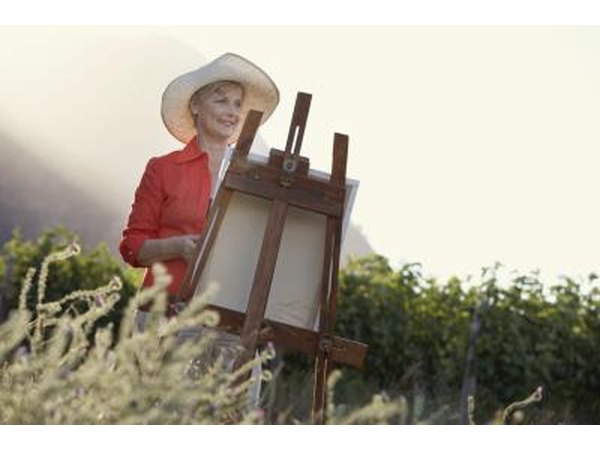 Woman painting in field