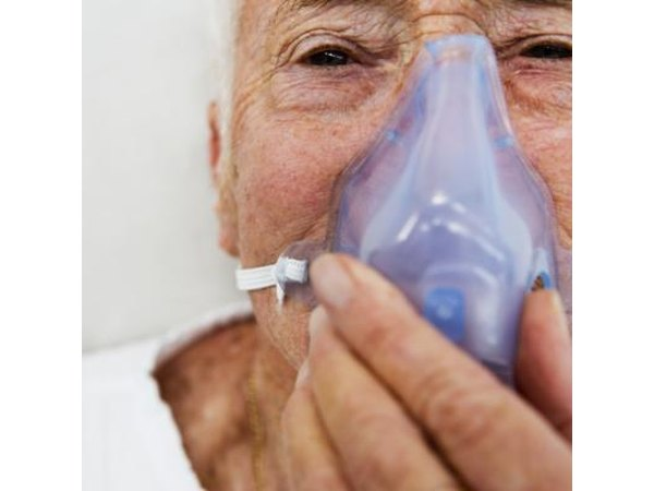 Older man with a plastic breathing mask