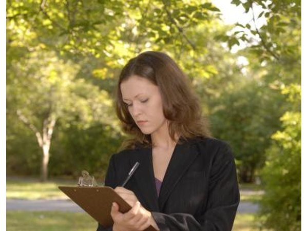 Woman with clipboard outdoors