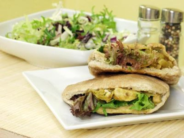 Pita bread sandwich and salad.