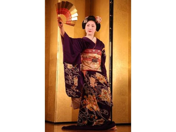 Geishas undergo training in Japanese traditional arts.