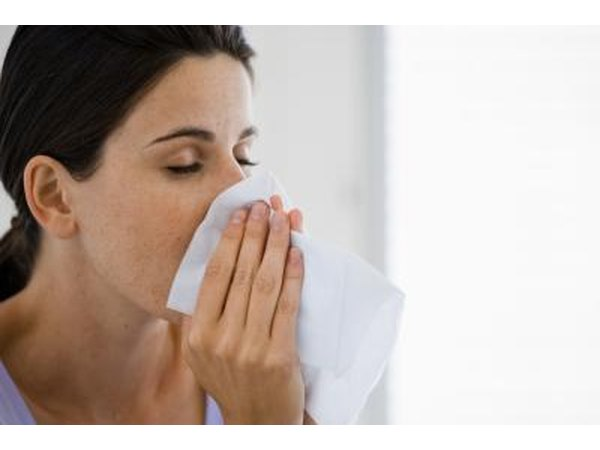 Allergy symptoms may include coughing, sneezing, runny nose, sinus congestion that can cause headaches, itchy throat and red, swollen itchy eyes.