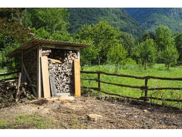 A small stand alone firewood shed.