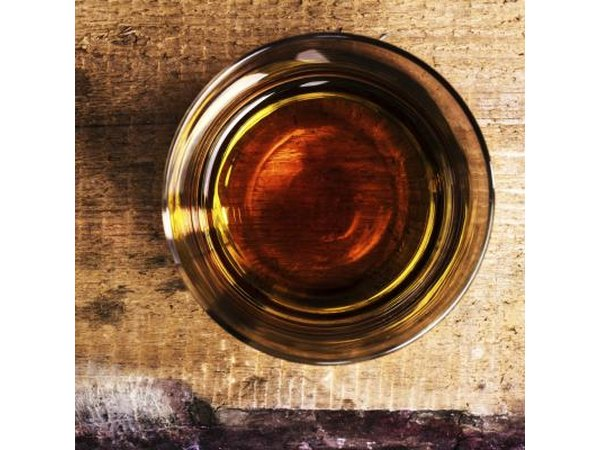 Top view of a shot of whiskey on counter