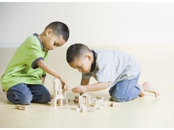 Two boys playing with building blocks