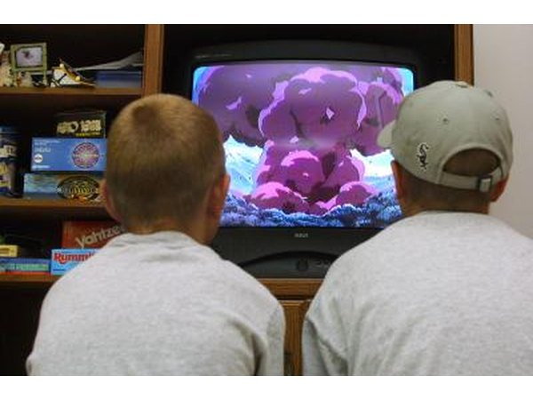 Boys watching movie on PlayStation console