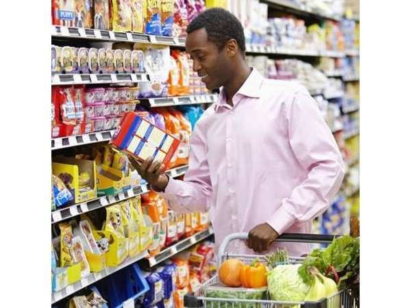 A man reading a nutritional label