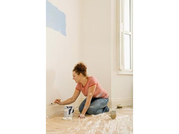 Paint the wall space between moldings to create the illusion of a taller baseboard.